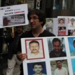 Baloch activists holding pictures of abducted Baloch