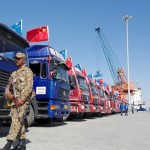 annweekly26 - A row of Chinese trucks carrying the goods parked at the Gwadar port, in Pakistan.   Credit: Khurram Husain, Dawn##########Nil ##########KHURRAM HUSAIN, DAWN